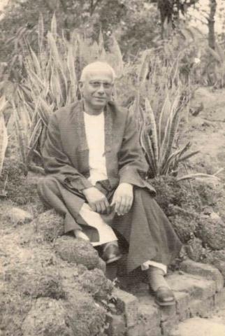 Rathindranath at the rockery outside Guha Ghor in Santiniketan: 1952