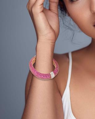 A pink sapphire and diamond bangle