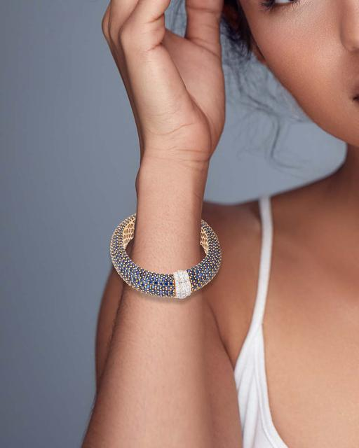 A blue sapphire and diamond bangle